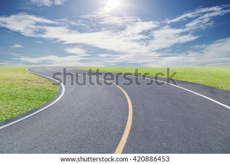 Roads Curve with green grass blue sky and cloud background - stock photo