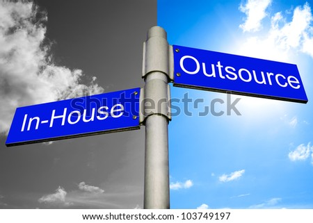 roads signs showing the ways to in-house and outsource - stock photo
