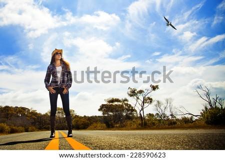 Roadside cowgirl - stock photo