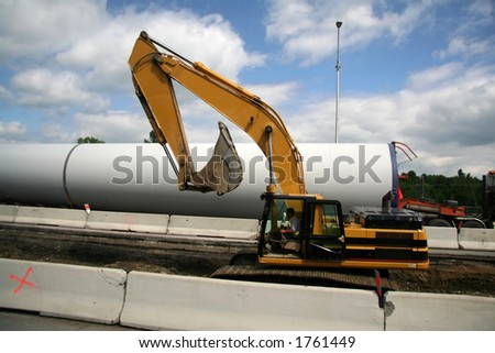 Roadside Excavator Contructing a New Highway - stock photo