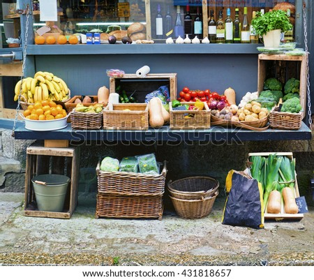 Roadside vegetable display;  fruit and vegetables displayed outside small greengrocersâ?? store  - stock photo