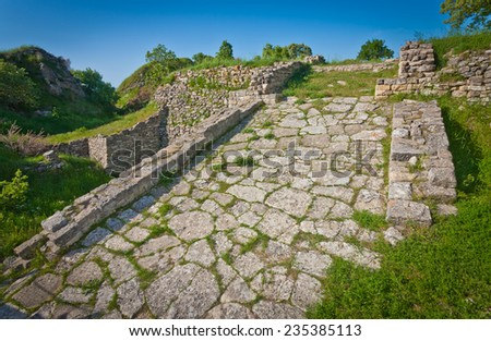 Roadway atop acropolis wall at Troy in Turkey - stock photo