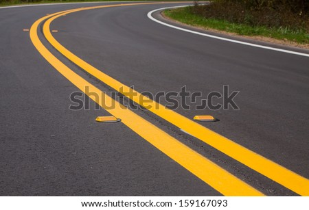 Roadway divider lines and markers - stock photo
