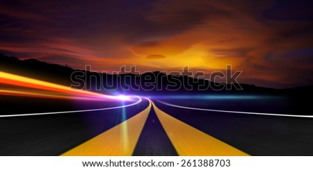 Roadway with Trails of light and flare at sunrise - stock photo