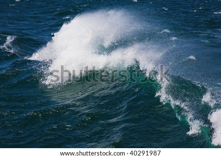 Roaring ocean wave curling under the  powerful force of nature - stock photo