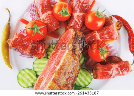 roast beef meat rolls and chunk on white platter - stock photo