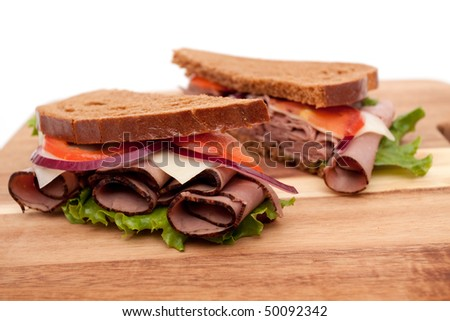 Roast beef sandwich cut in half - stock photo