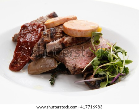 Roast beef served on a white dish - stock photo