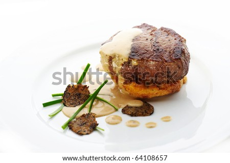 Roast beef with brown sauce and sliced truffles - stock photo