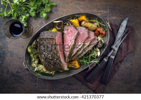 Roast Beef with Vegetable in Copper Pod - stock photo
