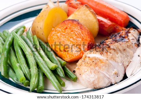 roast chicken dinner with sweet potato, carrots and beans - stock photo