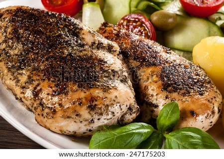 Roast chicken fillets, boiled potatoes and vegetables - stock photo