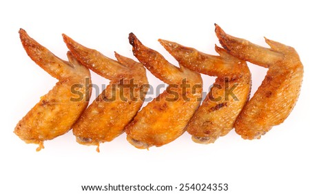 Roast chicken wings isolated on white background. - stock photo
