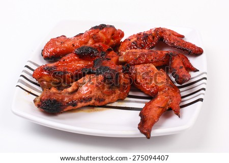 Roast chicken wings on a white background - stock photo