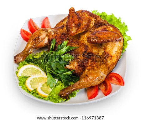 roast chicken with vegetables and lemon - stock photo