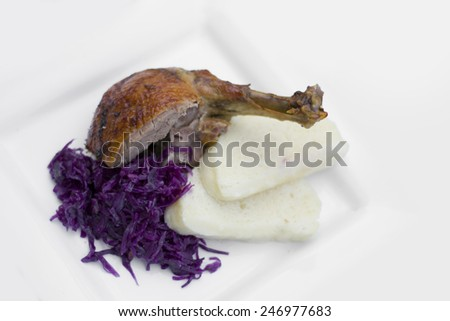 Roast duck with dumplings and red cabbage - stock photo