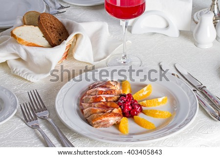 Roast duck with oranges and cherries - stock photo