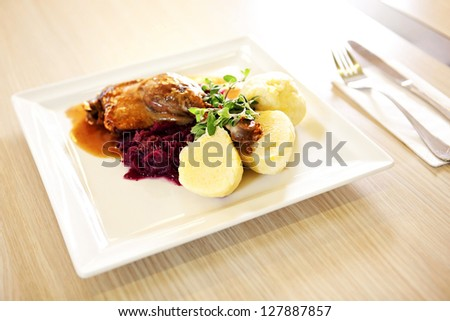 Roast duck with red cabbage and potato dumplings - stock photo