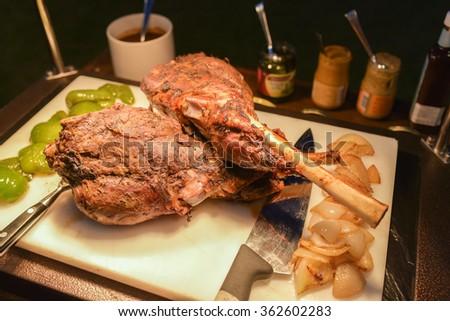 Roast leg of lamb. - stock photo