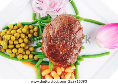 roast meat medalion on green beans with vegetables - stock photo