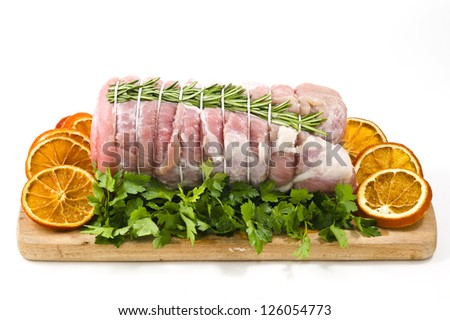roast of veal with rosemary and orange slices - stock photo