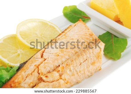 roast salmon fillet with butter on white plate - stock photo