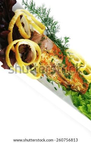 roast tuna steak served on white ceramic dish - stock photo