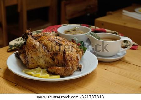 Roast Turkey, Stuffing, Gravy on a table, Selective focus - stock photo
