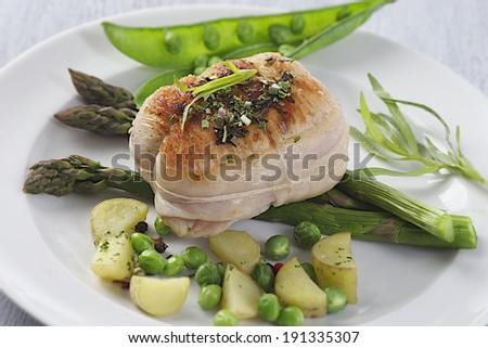 roast veal roulade with vegetables - stock photo