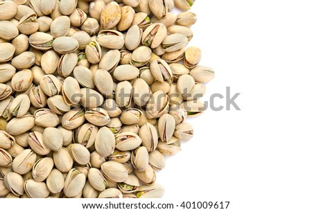 Roasted and salted pistachios in shell on white background - stock photo