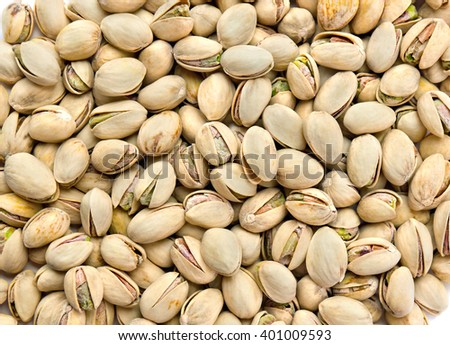 Roasted and salted pistachios in shell (texture, background) - stock photo