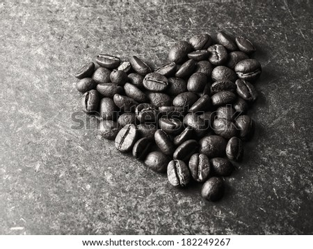 Roasted Arabica Coffee Bean, vintage monotone color background  - stock photo