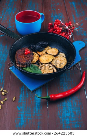 Roasted beef steak with eggplant and prunes. Meat dishes. Vegetables with meat. Wooden board rustic - stock photo