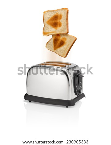 Roasted bread slices with roasted heart symbol is flying out from toaster with motion blur. Love the bread slices or love at the bread slices. - stock photo