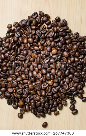 Roasted brown coffee beans, can be used as a background - stock photo