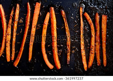 Roasted carrots with caraway food close up - stock photo