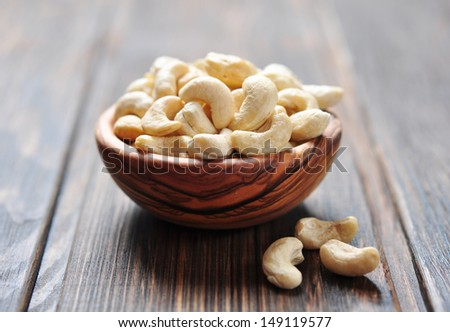 Roasted cashews on natural wooden table background - stock photo