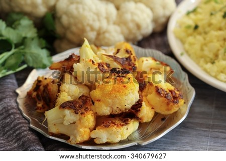 Roasted cauliflower florets, selective focus - stock photo