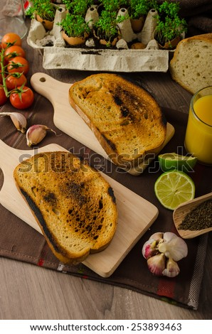 Roasted Cherry Tomato Sauce and Ricotta on Toast, preparing toasts - stock photo