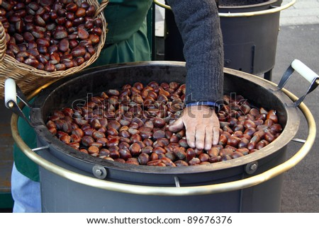 Roasted chestnuts at street vendor - stock photo