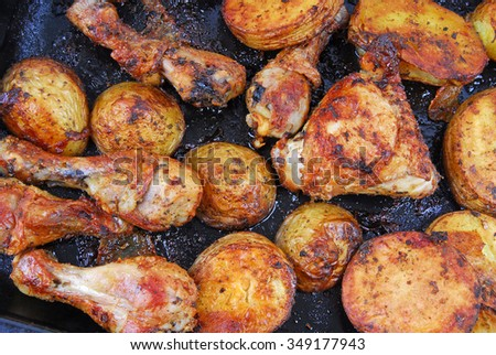 roasted chicken and potatoes - stock photo