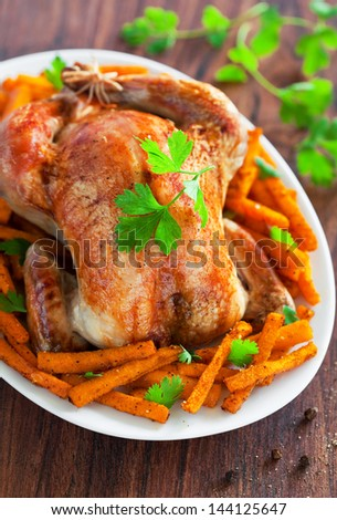 Roasted chicken and spicy pumpkin. Selective focus - stock photo