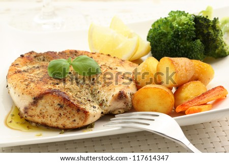 roasted chicken breast with potatoes - stock photo