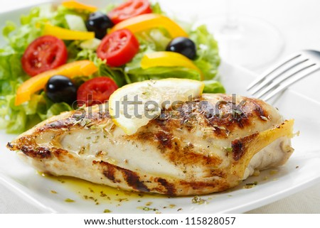 roasted chicken breast with salad - stock photo