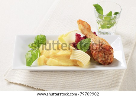 Roasted chicken drumstick served with mashed potato - stock photo