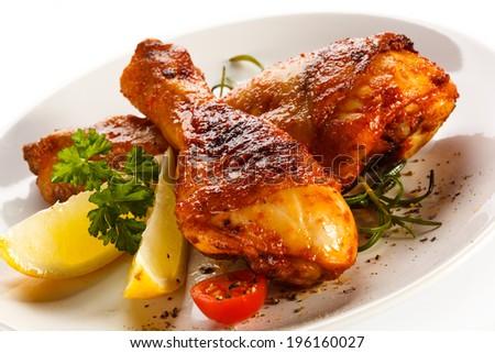 Roasted chicken drumsticks  - stock photo