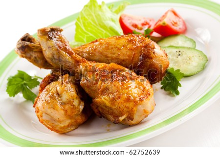 Roasted chicken leg and vegetables - stock photo