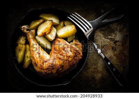 roasted chicken leg with potatoes - stock photo