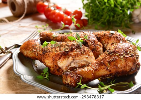 Roasted chicken legs with thyme - stock photo