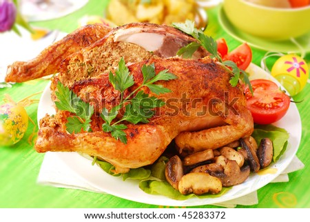 roasted chicken stuffed with liver and parsley for easter dinner - stock photo
